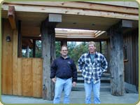 Cloud and Richard pose in front of the finished project. Shown: wrc fascia and soffit.