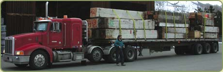 Our driver mark arriving with a load of 50.000 board feet of reclaimed lumber to be milled.